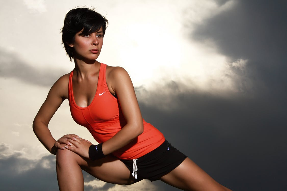 femme etirer sport